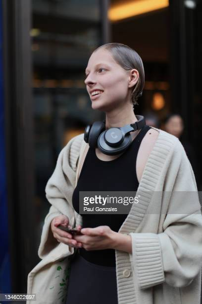 Model is seen wearing a Taupe Cardigan at Richard Quinn, during London Fashion Week September 2021 on September 21, 2021 in London, England.