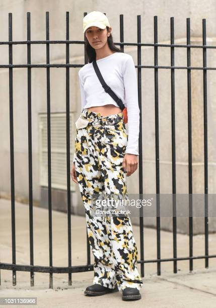 A model is seen wearing a white top white cap and floral pants outside the 31 Phillip Lim show during New York Fashion Week Women's S/S 2019 on...