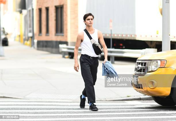 A model is seen wearing a white tshirt and balck jeans outside the Landlord show during New York Fashion Week Men's S/S 2018 at Skylight Clarkson Sq...