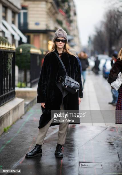 A model is seen wearing beanie sunglasses outside Stephane Rolland during Haute Couture Spring Summer 2019 Day Two on January 22 2019 in Paris France