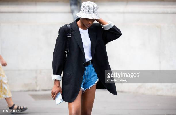 Model is seen wearing bucket hat outside Redemption during Paris Fashion Week - Haute Couture Fall/Winter 2019/2020 on June 30, 2019 in Paris, France.