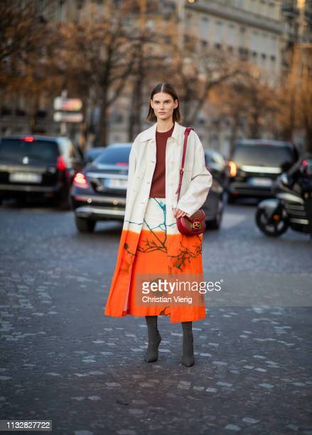 A model is seen wearing coat and skirt with print outside Rochas during Paris Fashion Week Womenswear Fall/Winter 2019/2020 on February 27 2019 in...