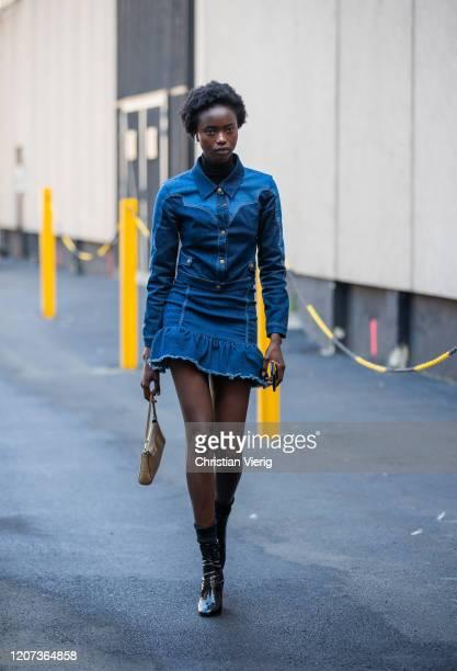A model is seen wearing denim dress outside Alberta Ferretti during Milan Fashion Week Fall/Winter 20202021 on February 19 2020 in Milan Italy