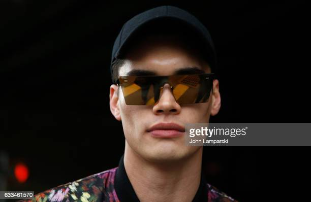 A model is seen wearing eye glass detail black hat outisde the Nautica fashion show during New York Men's Fashion Week AW17 on February 1 2017 in New...