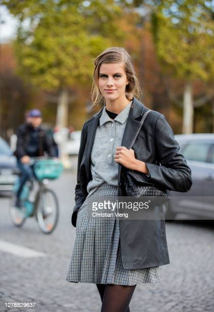 Model is seen wearing grey checkered skirt, button shirt, black jacket, bag outside Chanel during Paris Fashion Week - Womenswear Spring Summer 2021...