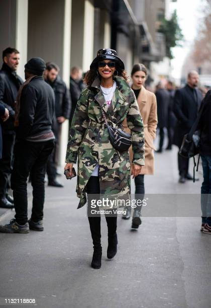 A model is seen wearing hat camouflage jacket outside Dolce Gabbana on Day 5 Milan Fashion Week Autumn/Winter 2019/20 on February 24 2019 in Milan...