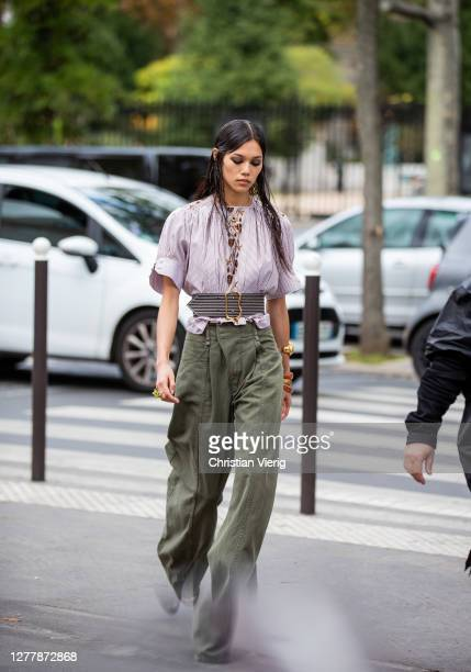 A model is seen wearing olive high waisted pants outside Chloe during Paris Fashion Week Womenswear Spring Summer 2021 Day Four on October 01 2020 in...