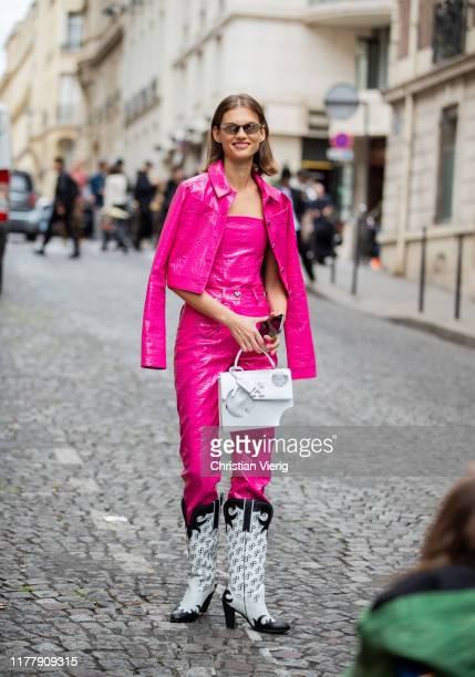 Model is seen wearing pink jacket and pants, Cowboy boots, white bag outside Altuzarra during Paris Fashion Week Womenswear Spring Summer 2020 on...