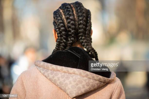 Model is seen with cornrows hair outside Dior during Paris Fashion Week - Haute Couture Spring Summer 2019 on January 21, 2019 in Paris, France.