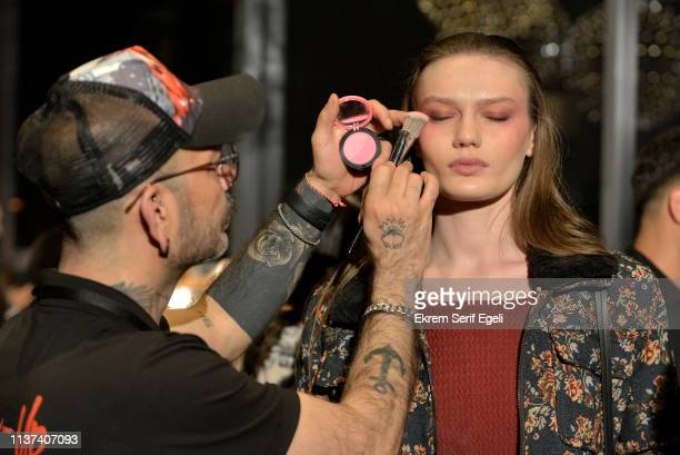 A model is styled backstage at the Ezra Tuba show during MercedesBenz Istanbul Fashion Week on March 21 2019 in Istanbul Turkey