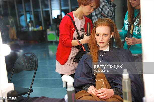 Model is styled backstage at the Jonathan Saunders autumn 2011 collection at Level 2, Paddington Central in London on 19 February 2011.
