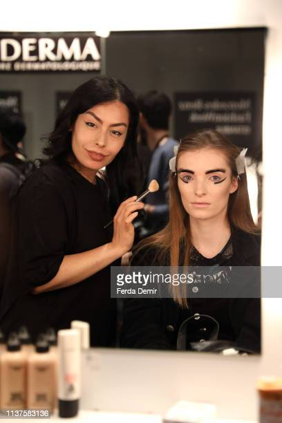 A model is styled backstage at the MiiN by Kadir Kilic show during MercedesBenz Istanbul Fashion Week at Zorlu Performance Hall on March 22 2019 in...