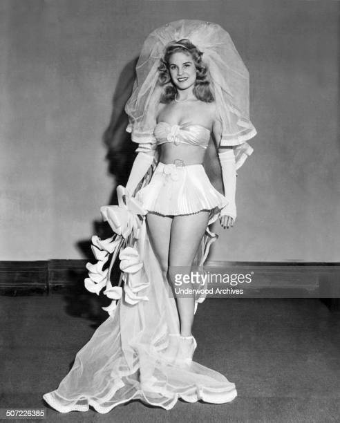 A model is the bride of the future wearing spunglass pants and bra glass net veil and a brief skirt of accordionpleated glass satin June 1947