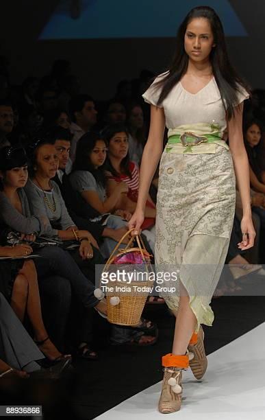 Model is walking on the ramp with Fashion designer Agnimitra Paul outfit at Lakme Fashion Week Spring Summer2007 in Mumbai Maharashtra India