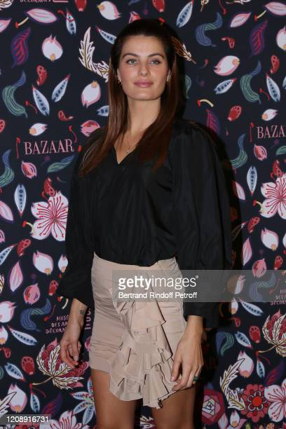 Model Isabeli Fontana attend the Harper's Bazaar Exhibition as part of the Paris Fashion Week Womenswear Fall/Winter 2020/2021 At Musee Des Arts...