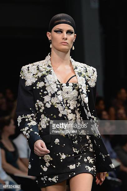 Model Isabeli Fontana the runway during the Givenchy show as part of the Paris Fashion Week Menswear Spring/Summer 2015 on June 27 2014 in Paris...