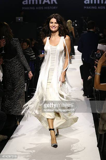 Model Isabeli Fontana walks during the fashion show runway during amfAR's 22nd Cinema Against AIDS Gala Presented By Bold Films And Harry Winston at...