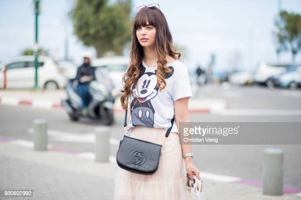 Model Iska wearing tshirt with Micky Mouse print is seen during Tel Aviv Fashion Week on March 11 2018 in Tel Aviv Israel
