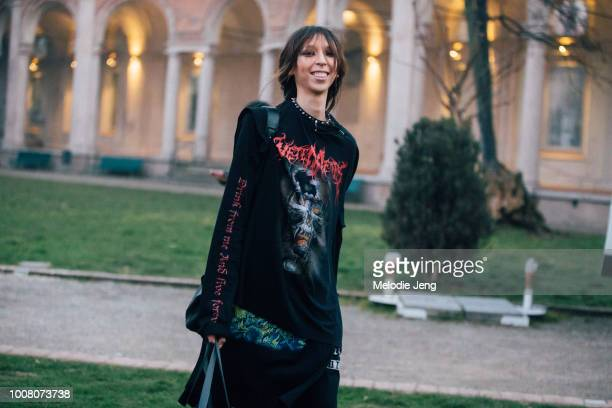 Model Issa Lish exits the Alberta Ferretto show in a spike-studded choker necklace and a black Vetements skull Drink from me and live forever shirt...