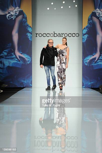 Model Ivana Mrazovan and designer Rocco Barocco acknowledge the applause of the audience after the Roccobarocco Autumn/Winter 2012/2013 fashion show...