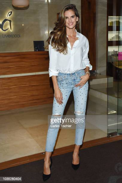 Model Izabel Goulart poses for photos during a store tour as part of the Liverpool Fashion Fest 2018 at Liverpool Polanco on September 11 2018 in...
