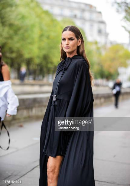 Model Izabel Goulart seen wearing black dress with cape outside Valentino during Paris Fashion Week Womenswear Spring Summer 2020 on September 29...