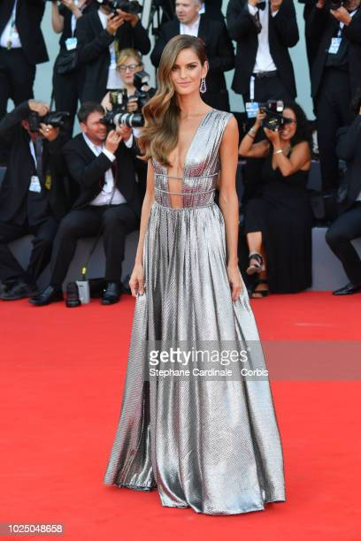 Model Izabel Goulart walks the red carpet ahead of the opening ceremony and the 'First Man' screening during the 75th Venice Film Festival at Sala...