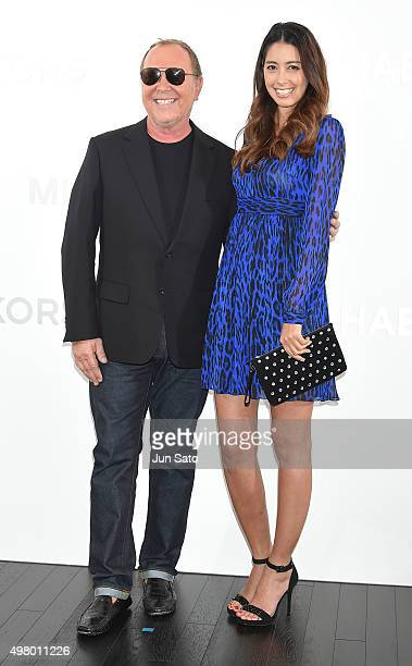 Model Izumi Mori and designer Michael Kors attend the opening event for the Michael Kors Ginza Flagship Store on November 20 2015 in Tokyo Japan