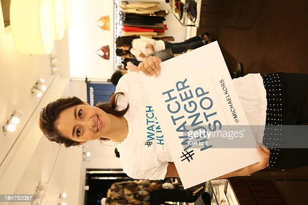 Model Izumi Mori is seen at Michael Kors World Food Day event at Omotesando on October 16 2013 in Tokyo Japan