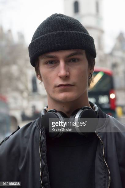 Model Jack Chambers wears a Misbehaved bomber jacket and jumper day 3 of London Mens Fashion Week Autumn/Winter 2018 on January 08 2018 in London...