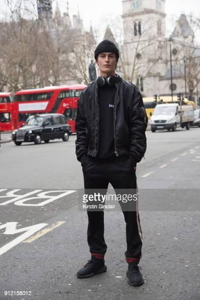 Model Jack Chambers wears a Misbehaved bomber jacket and jumper Gucci trousers and Yeezy trainers day 3 of London Mens Fashion Week Autumn/Winter...