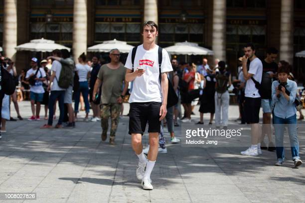 Model Jack Chambers wears a white Supreme tshirt black shorts Nike socks and Gucci sneakers after the Louis Vuitton show during Paris Fashion Week...