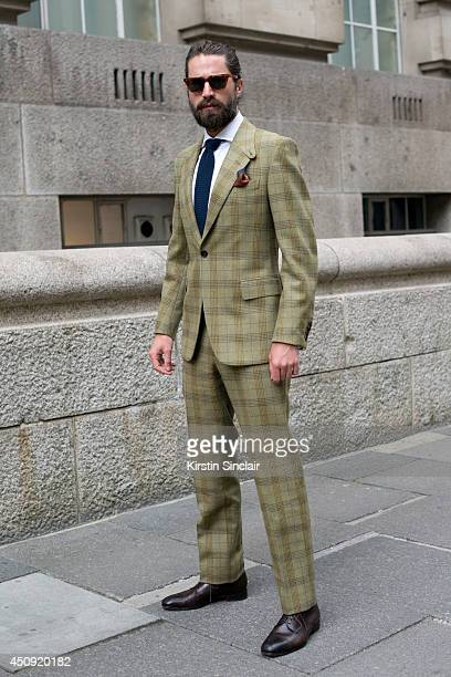 Model Jack Guinness wears a Huntsman suit Toms sunglasses and Jimmy Choo shoes on day 2 of London Collections Men on June 16 2014 in London England