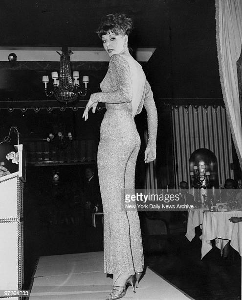 Model Jackie Blanchard models beaded hostess pajamas worn by Angie Dickenson in movie Art of Love at the WaldorfAstoria