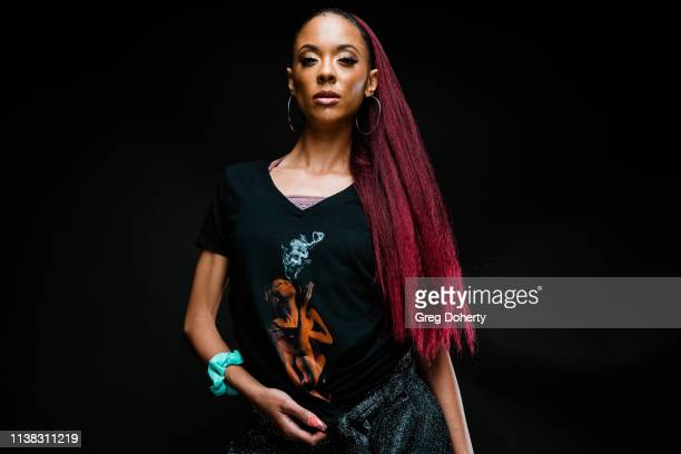 Model Jacky Reyes wearing a Cannacity Shirt Design with Photography by Michael Bezjian attends the Welcome to Cannacity 'She's Smokin' Event on April...