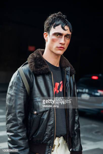 Model Jacob Bixenman exits the Palomo Spain show in hair and makeup and wears a brown leather jacket with a DARE tshirt during New York Fashion Week...