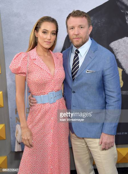 Model Jacqui Ainsley and director Guy Ritchie attends the premiere of Warner Bros Pictures' 'King Arthur Legend Of The Sword' at TCL Chinese Theatre...