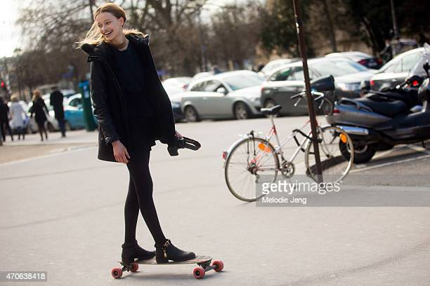 Model Jade de Lavareille exits the Guy Laroche show at Grand Palais on a longboard on Day 2 of Paris Fashion Week FW15 March 4 2015 in Paris France