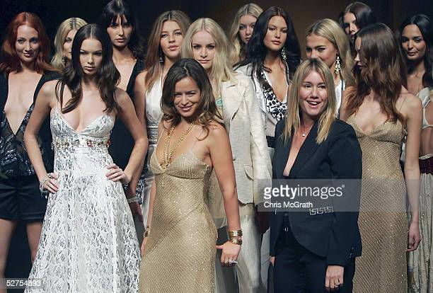 Model Jade Jagger , daughter of Mick Jagger, walks the runway with fashion designer Charlie Brown after the Princess Charlotte collection show by...