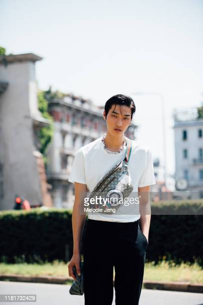 Model Jae Hyung An wears a Gucci fanny pack after the Pal Zileri show during the Milan Men's Fashion Week Spring/Summer 2020 on June 17, 2019 in...