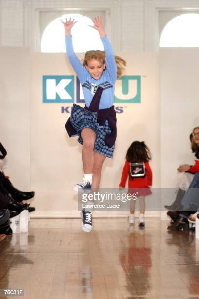Model Jamie Lynn Spears begins a cartwheel while participating in the Fall 2002 Kids R Us fashion runway show April 11 2002 in New York City Spears...