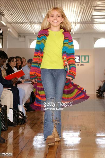 Model Jamie Lynn Spears participates in the Fall 2002 Kids R Us fashion runway show April 11 2002 in New York City Spears wears a multicolored duster...