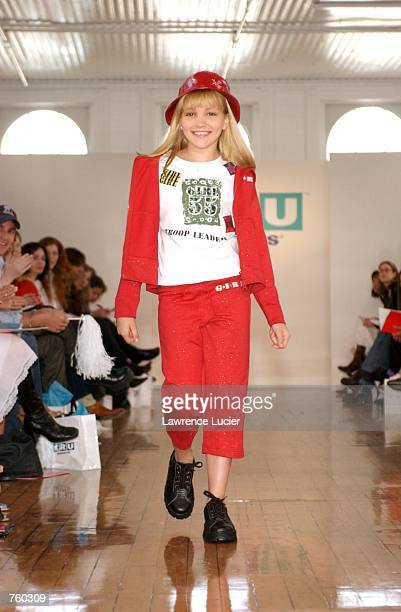 Model Jamie Lynn Spears participates in the Fall 2002 Kids R Us fashion runway show April 11 2002 in New York City Spears wears a red glitter...