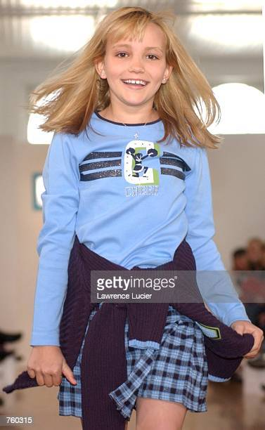 Model Jamie Lynn Spears participates in the Fall 2002 Kids R Us fashion runway show April 11 2002 in New York City Spears is wearing a blue long...