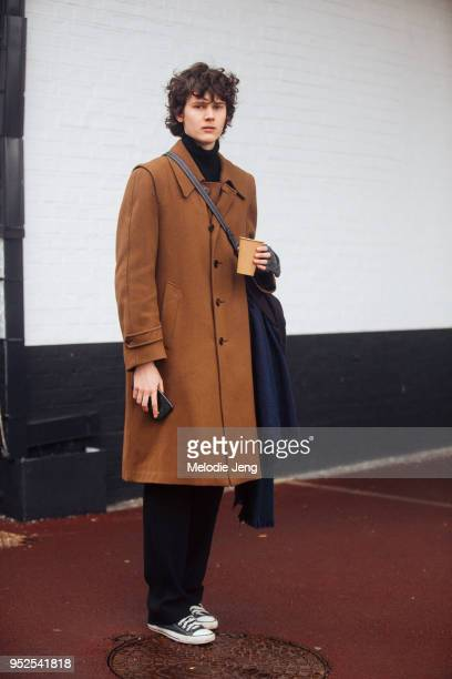Model Jamily Wernke Meurer wears a brown coat black pants and black Converse shoes on March 04 2018 in Paris France