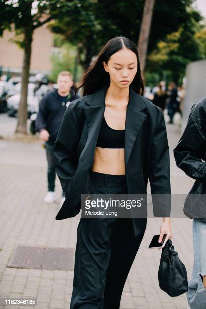Model Jan Baiboon wears a black suit with a black bra after the Burberry show during London Fashion Week September 2019 on September 16, 2019 in...