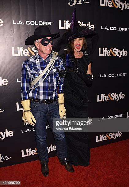 Model Janice Dickinson and Dr Robert Rocky Gerner arrive at the Life Style Weekly's Eye Candy Halloween Bash hosted by LeAnn Rimes at Riviera 31 at...