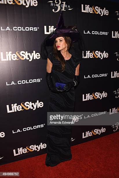 Model Janice Dickinson arrives at the Life Style Weekly's 'Eye Candy' Halloween Bash hosted by LeAnn Rimes at Riviera 31 at Sofitel on October 29...