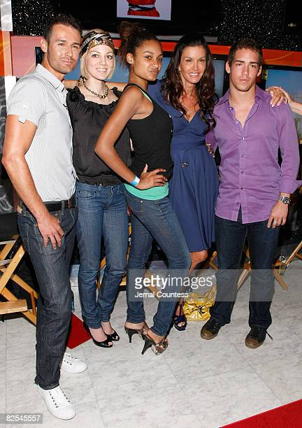 Model Janice Dickinson poses with contest winner Amber her son Nathan Fields JP Calderon and Crystal Shuhorn attend the model walkoff competition at...