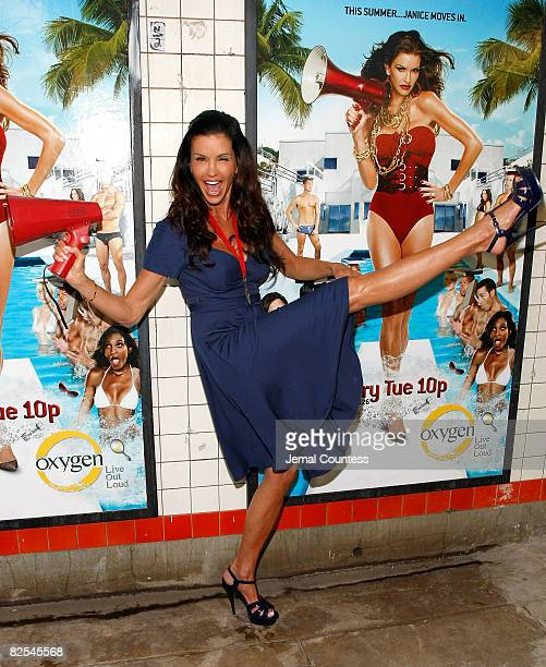 Model Janice Dickinson poses with posters advertising the premiere of her new show following a model walkoff competition at the NBC Experience Store...
